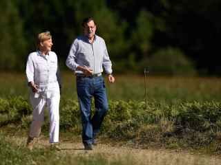 El presidente del Gobierno, Mariano Rajoy, y Angela Merkel en agosto de 2014. / Getty Images