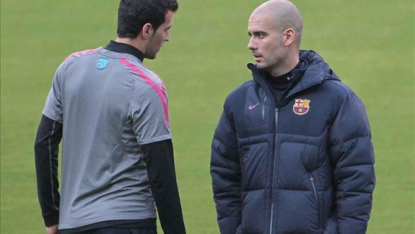 Busquets y Guardiola, durante su etapa en común en Can Barça.