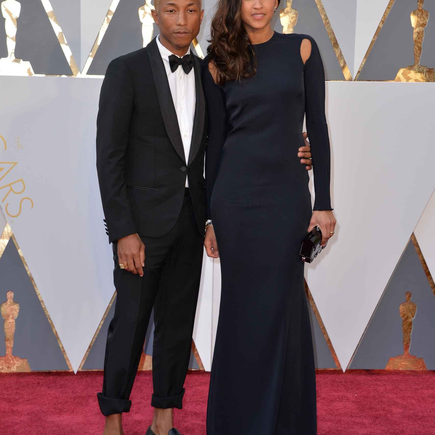 Pharrell Williams esta vez sólo se ha remangado los bajos del smoking y Helen Lasichanh