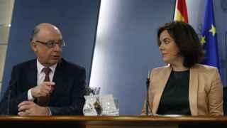Soraya y Montoro celebran la caída de Soria en contra del criterio de Rajoy