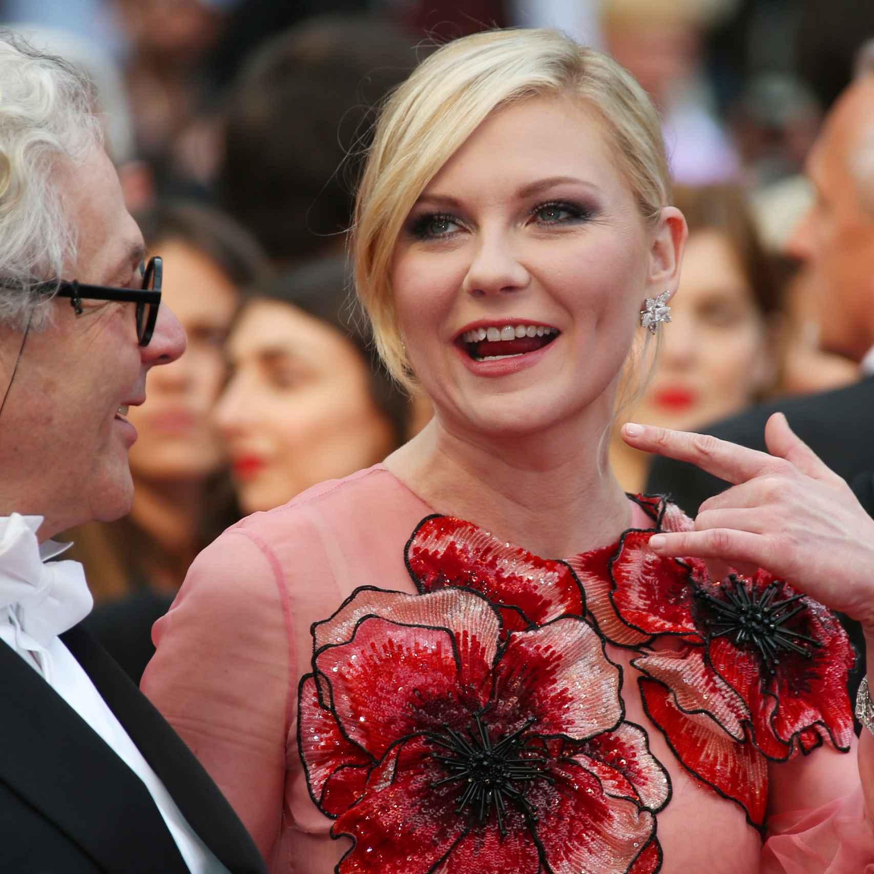 Kirsten Dunst con el presidente del jurado de Cannes, Jury George Miller