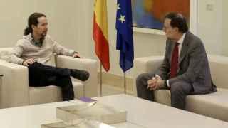 Mariano Rajoy junto con Pablo Iglesias.
