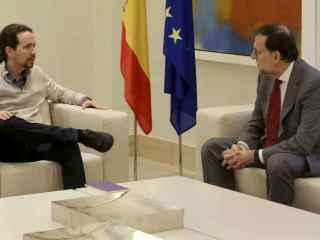 El líder del PP junto con Pablo Iglesias.