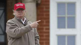 File photo of U.S. Republican presidential candidate and businessman Donald Trump gesturing outside his hotel at the Trump Turnberry Resort in Scotland