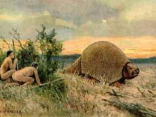 Ilustración que representa a dos pobladores antiguos de América con un glyptodon.