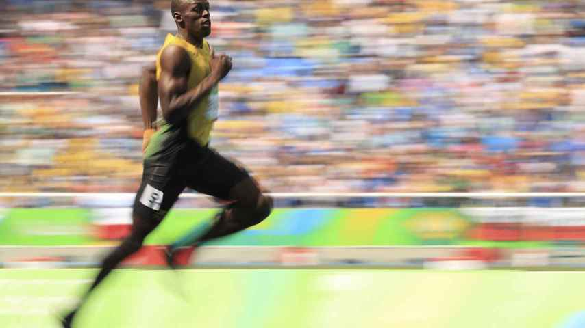 Usain Bolt en las series del 200. / Reuters