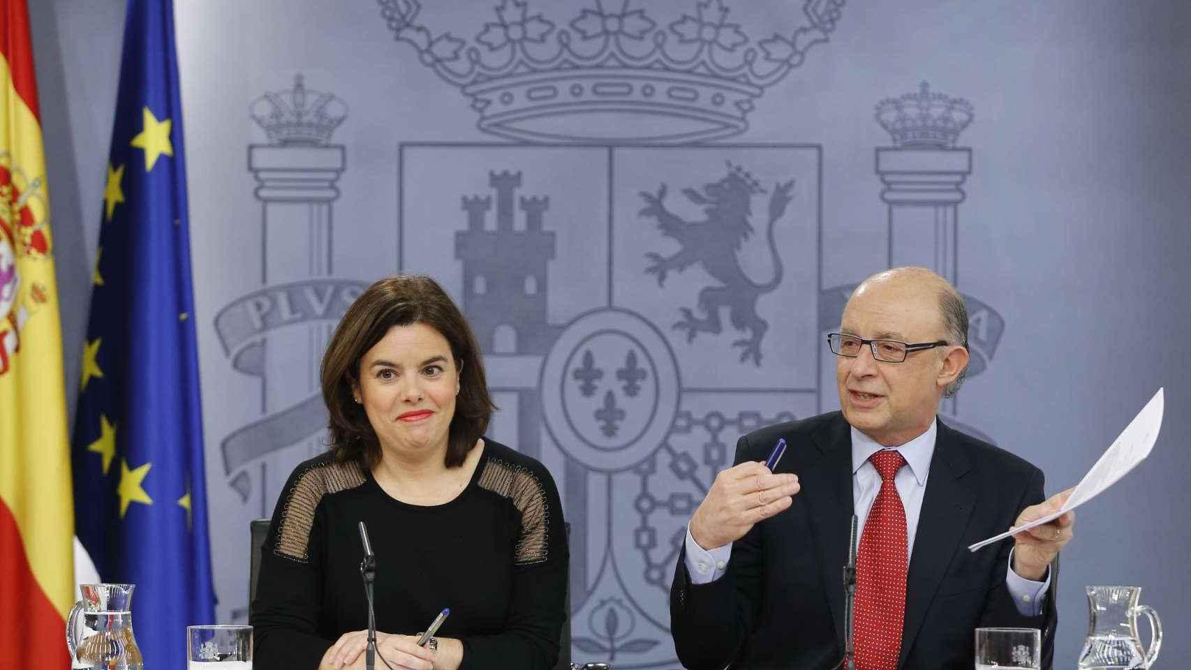 Cristóbal Montoro y Soraya Sáenz de Santamaría
