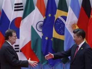 Mariano Rajoy saluda al presidente chino, Xi Jinping, al inicio de la cumbre del G-20.