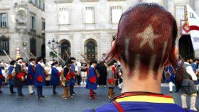 Una militante independentista en uno de los actos de la Diada.