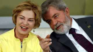 Brazil's President  Lula da Silva talks with his wife Marisa Leticia during a ceremony at Planalto Palace in Brasilia