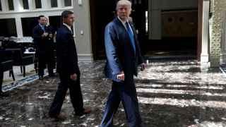 Republican presidential nominee Donald Trump walks through atrium of his new Trump International Hotel in Washington