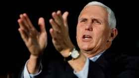 Indiana Governor Mike Pence, the Republican vice presidential nominee, cheers for the audience during a rally in Charlotte