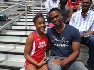 Tyson Gay, junto a su hija Trinity.