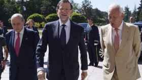 Los exministros José Manuel García-Margallo y Jorge Fernández Díaz con Mariano Rajoy.