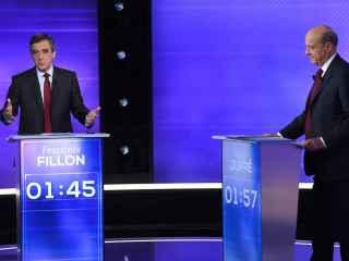 Fillon y Juppé, durante el debate por las primarias.