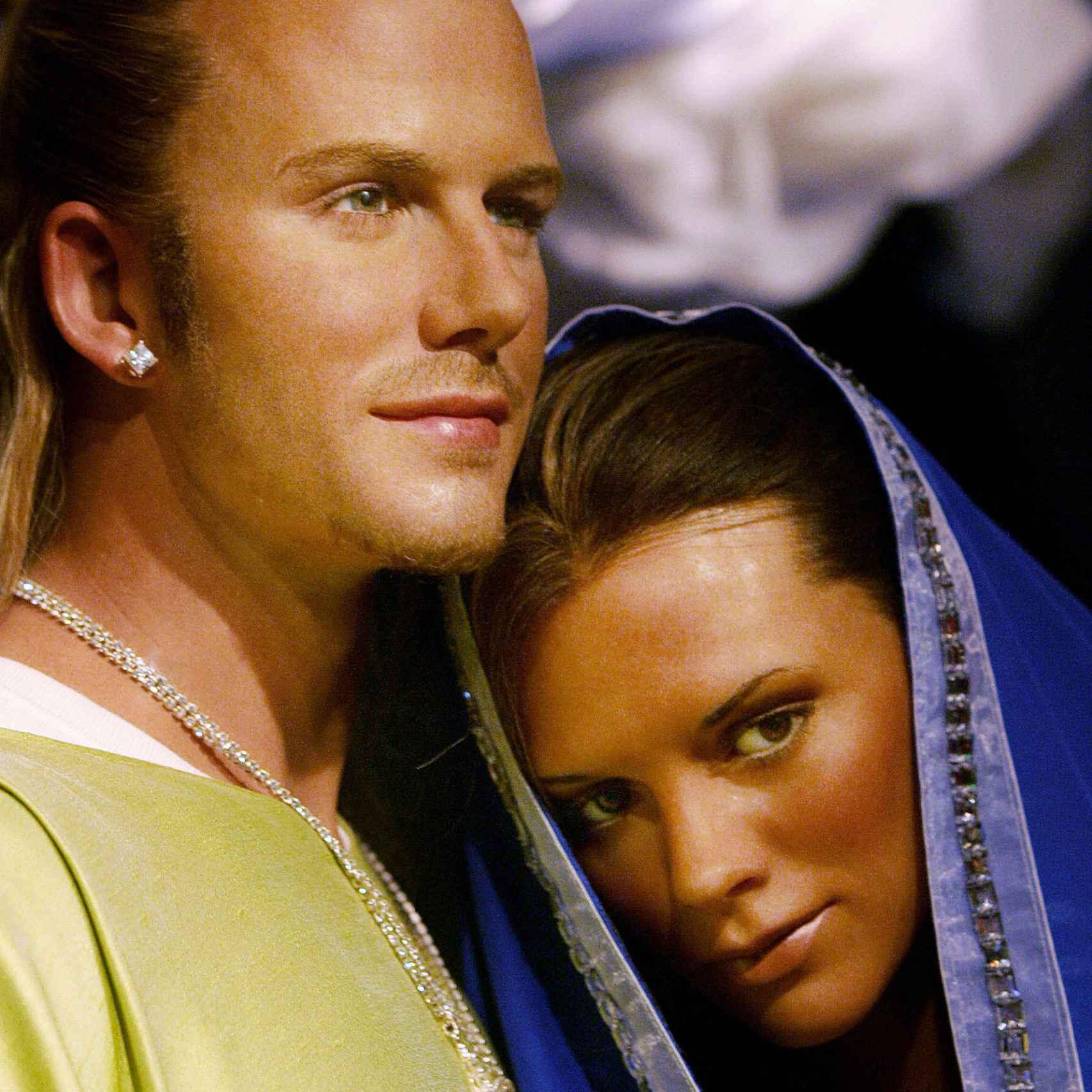 David y Victoria Beckham como José y María en el Madame Tussauds de Londres