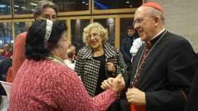 Manuela Carmena junto a Carlos Osoro durante la cena de Nochebuena