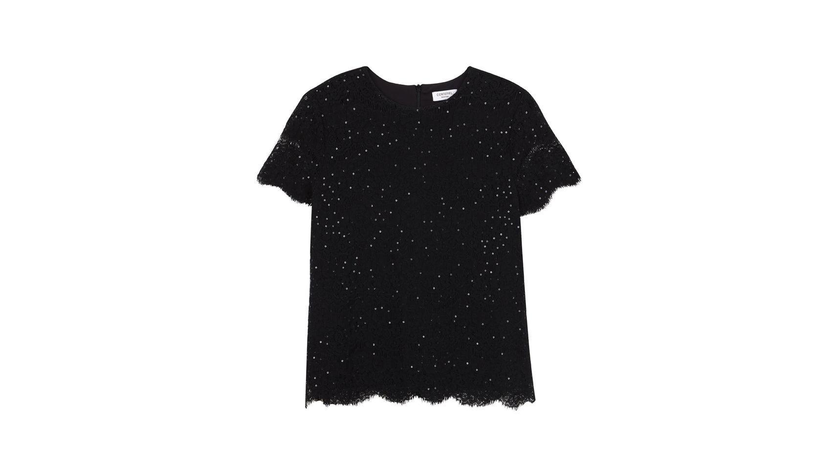 Esta blusa negra de Cortefiel te permitirá ser la reina de las estrellas. Precio: 49.99 euros.
