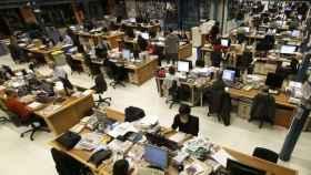 Trabajadores de El Periódico de Cataluña en su redacción de Barcelona.