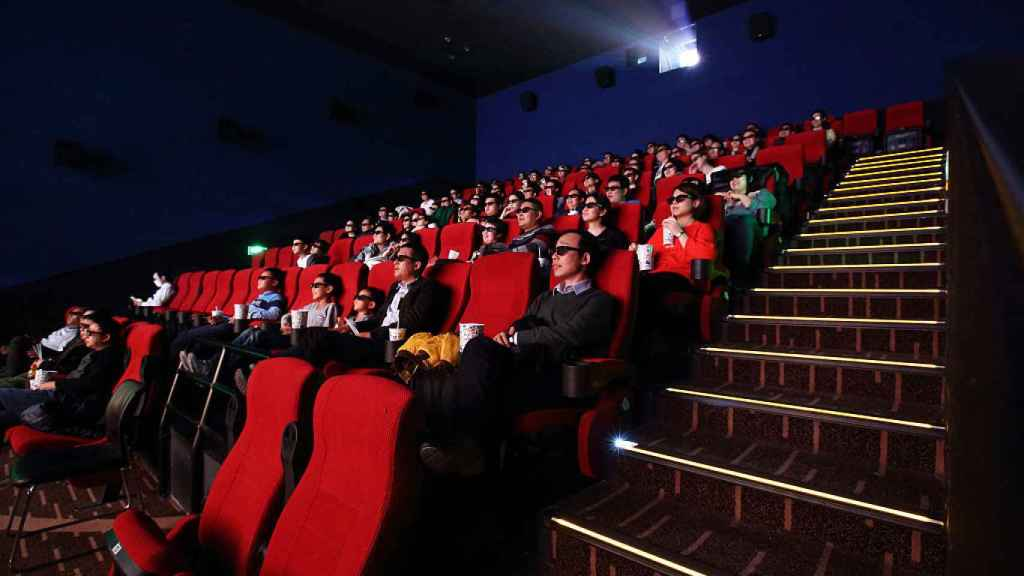 Espectadores en una sala de Beijing, China.