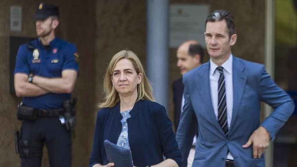 Cristina de Borbón e Iñaki Urgandarín tras una de las sesiones del juicio