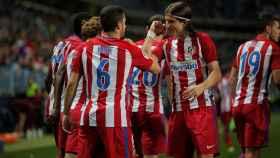 Los jugadores del Atlético celebran la victoria ante el Málaga.