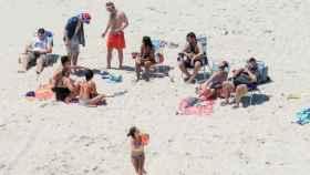 Chris Christie, a la derecha de la imagen, con su familia en la playa
