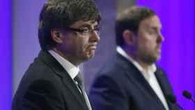 Puigdemont y Junqueras, durante la rueda de prensa en la que anunciaron los cambios en el Govern.