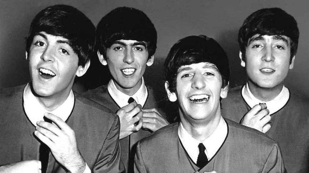Imagen de los cuatro integrantes del grupo.