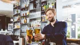 Barman serving beer in a pub