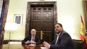 Cristóbal Montoro y Oriol Junqueras en una reunión en marzo en  Madrid.