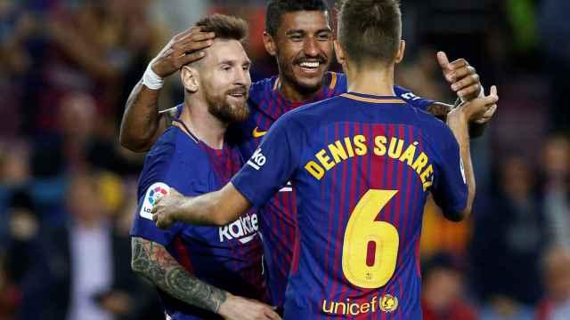 Messi, Paulinho y Denis Suárez en un partido del Barcelona.