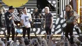 Los miembros del grupo One Direction durante uno de sus conciertos.