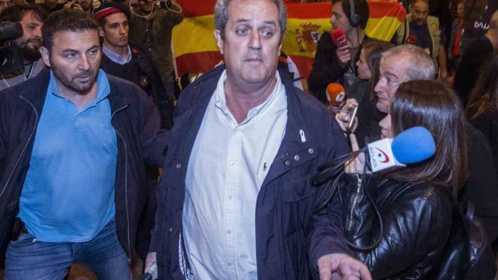 El exconseller de Interior, Joaquim Forn (c), a su llegada a Barcelona.