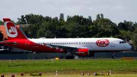 FILE PHOTO: An aircraft operated by German carrier Niki and Air Berlin sits on the tarmac of Berlin's Tegel