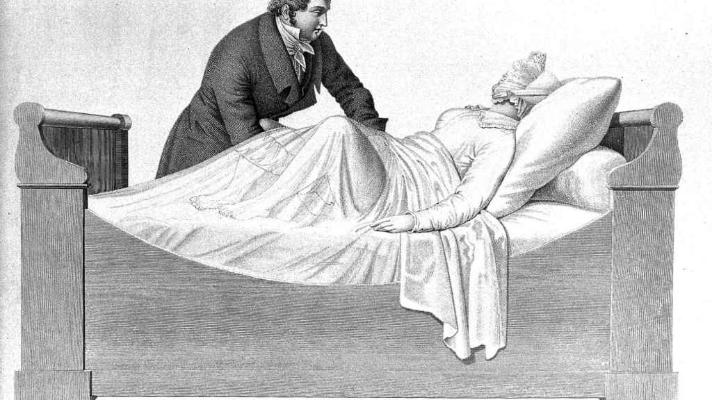 Un médico masajeando a su paciente en una ilustración francesa de 1825.