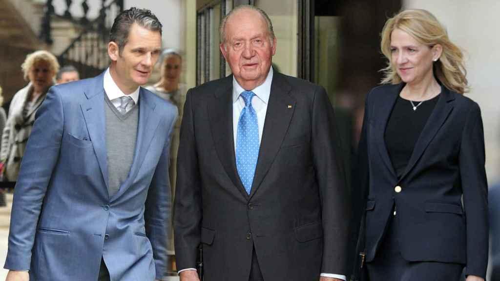 iñaki urdangarin y Juan Carlos I y la infanta Cristina.