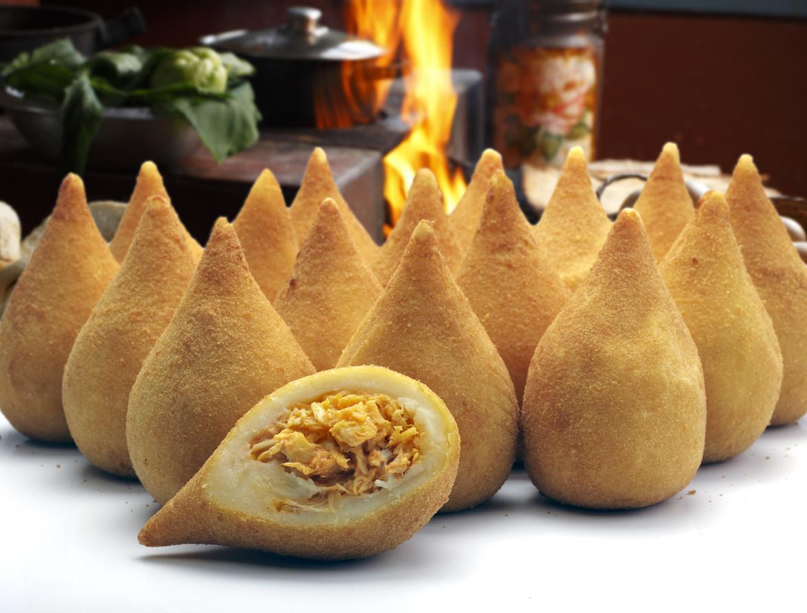 Coxinha de Galinha - Brazilian deep fried chicken snack, popular at local parties. Served with chili sauce.
