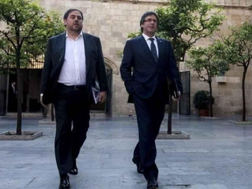 Oriol Junqueras y Carles Puigdemont acudiendo a un consejo de Gobierno.