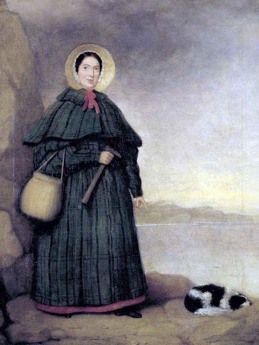 Retrato de Mary Anning con su perro Try y el afloramiento Golden Cap al fondo.