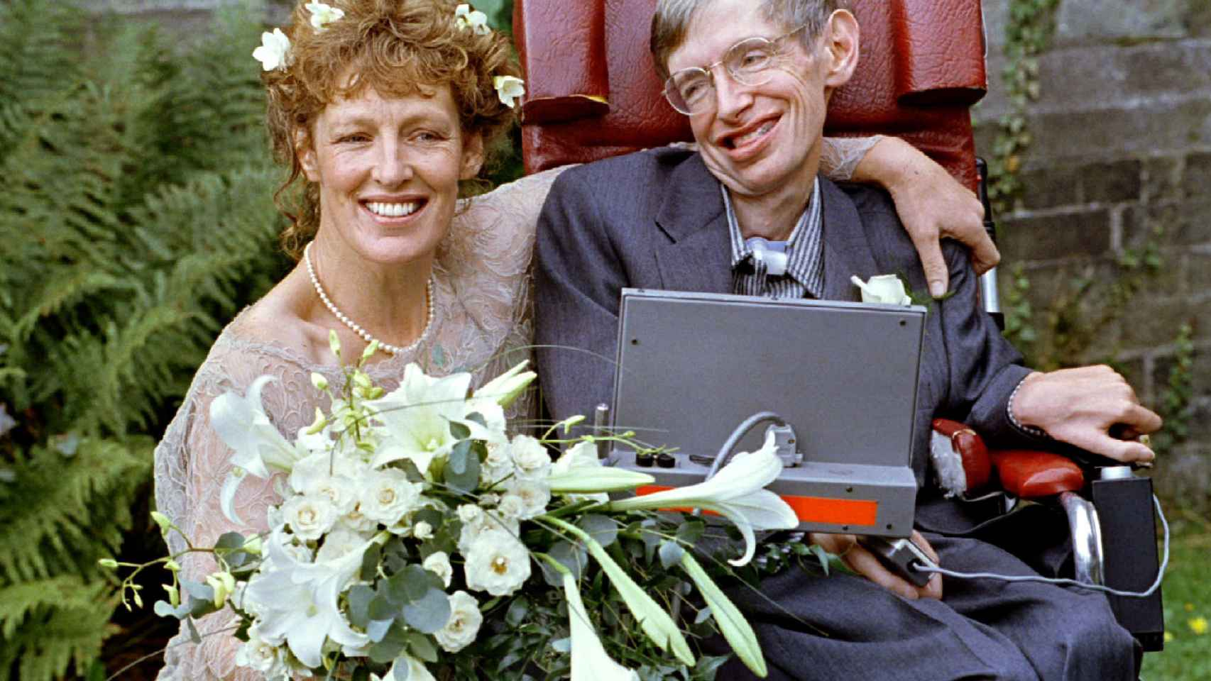 FILE PHOTO: Stephen Hawking and his new bride Elaine Mason pose for pictures after the blessing of their wedding at St. Barnabus Church