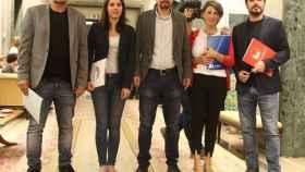 Iglesias junto a sus socios de IU, En Marea y En Comú.