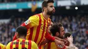 Piqué celebra un gol con el Barcelona.