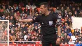 Estrada Fernández, árbitro de Primera división