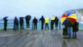A la playa con paraguas.