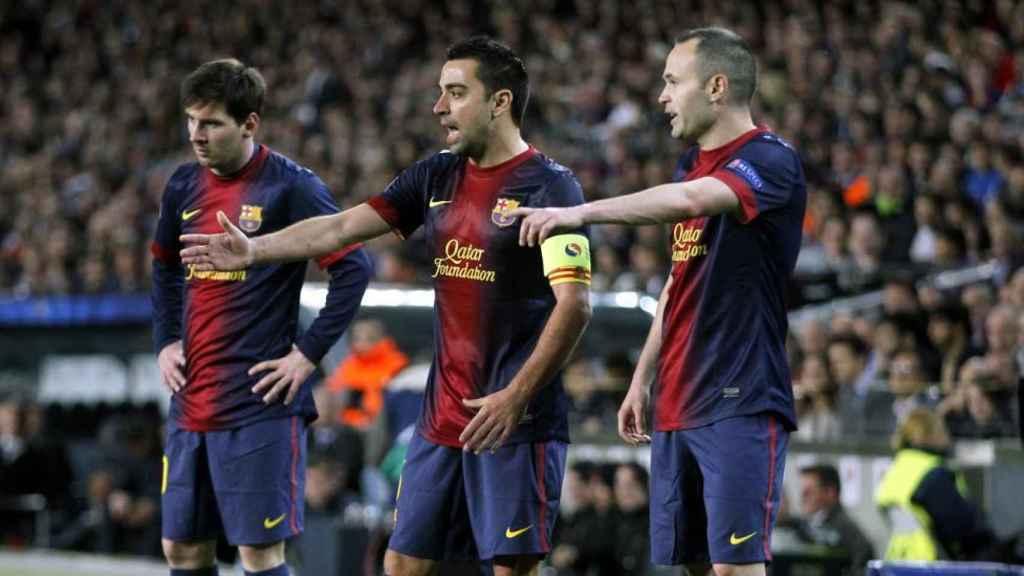 Messi, Xavi e Iniesta.