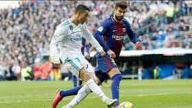 Cristiano Ronaldo ante Gerard Piqué