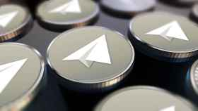Imagen representativa de criptomonedas con el logotipo de Telegram.