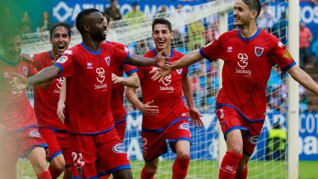 Los jugadores del Numancia celebran el gol decisivo de Diamanka.