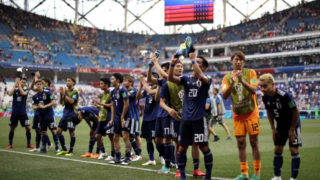 Los jugadores de Japón celebran el pase a octavos.